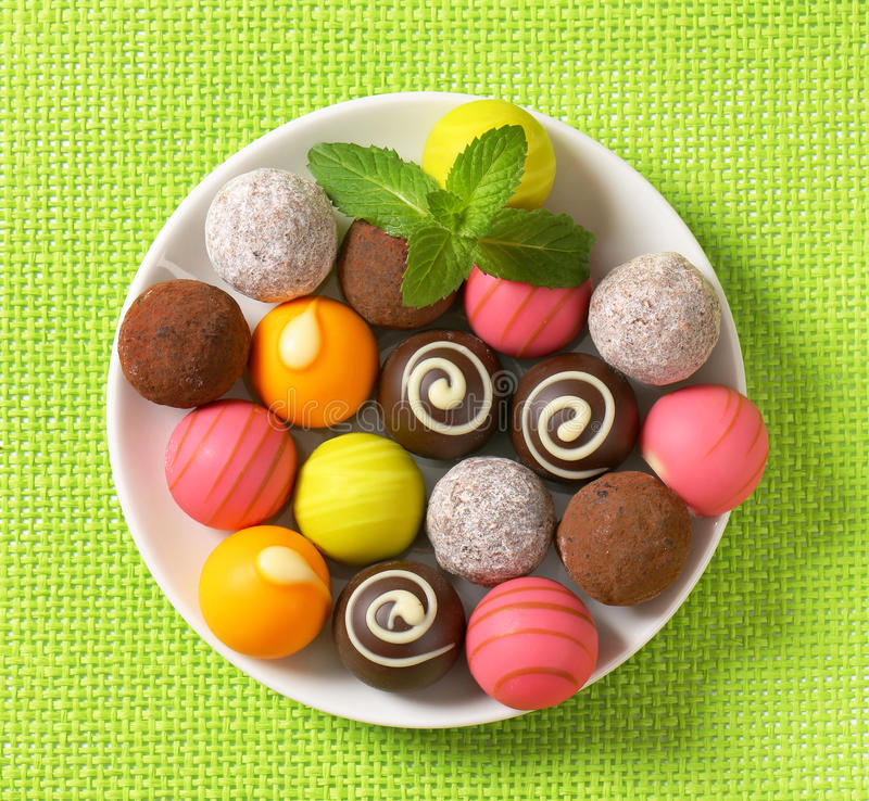 Assorted chocolate truffles and pralines. Assorted chocolate truffles and fruit ganache pralines stock image