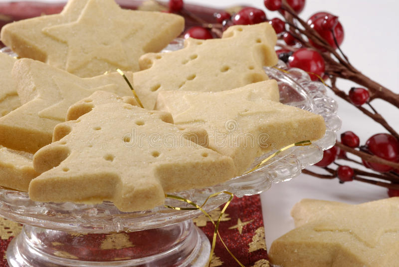 Assorted Christmas cookies. Assorted Christmas cookies on a glass plate. Christmas arrangement stock image