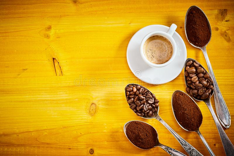 Assorted coffee beans and grounds with espresso stock photo