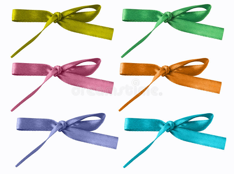Assorted colored bows. Isolated on a white background in yellow, green, pink, orange, purple, turquoise royalty free stock image