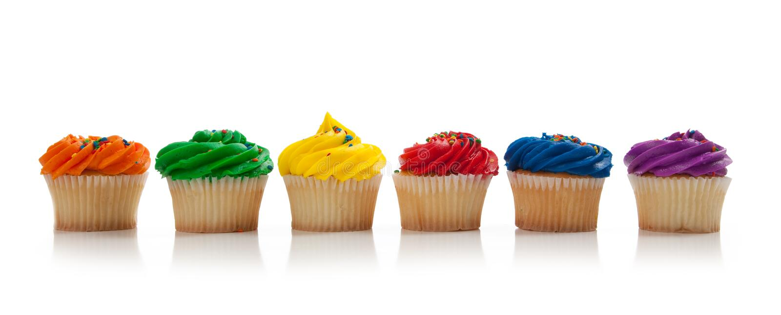 Assorted colored Cupcakes with sprinkles on white royalty free stock photos