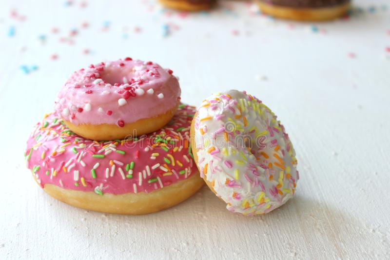 Assorted colorful donuts close-up. Photos of different donuts. Assorted colorful donuts in pink, green, chocolate icing close-up, sweet dessert.n stock photo