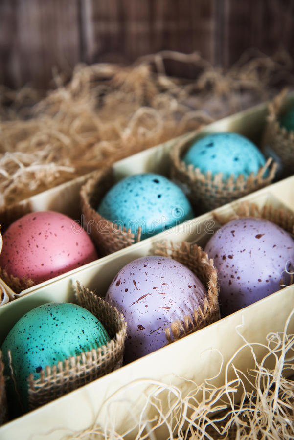 Assorted colorful painted easter eggs in a gift box, , with woodchips royalty free stock images