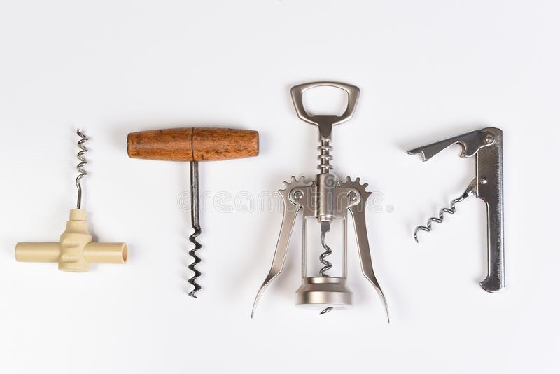 Assorted corkscrews on white. Four different styles of wine openers in a row royalty free stock photos
