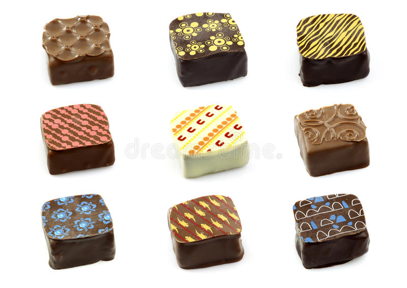 Assorted decorated luxury chocolate bonbons. Isolated on white stock photography