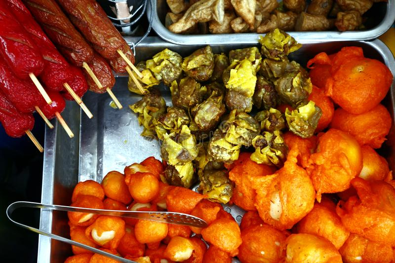 Assorted deep fried snack food in a street food cart stock photos