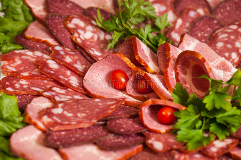 Assorted Deli Cold Meats. On a plate. Selective focus royalty free stock photos