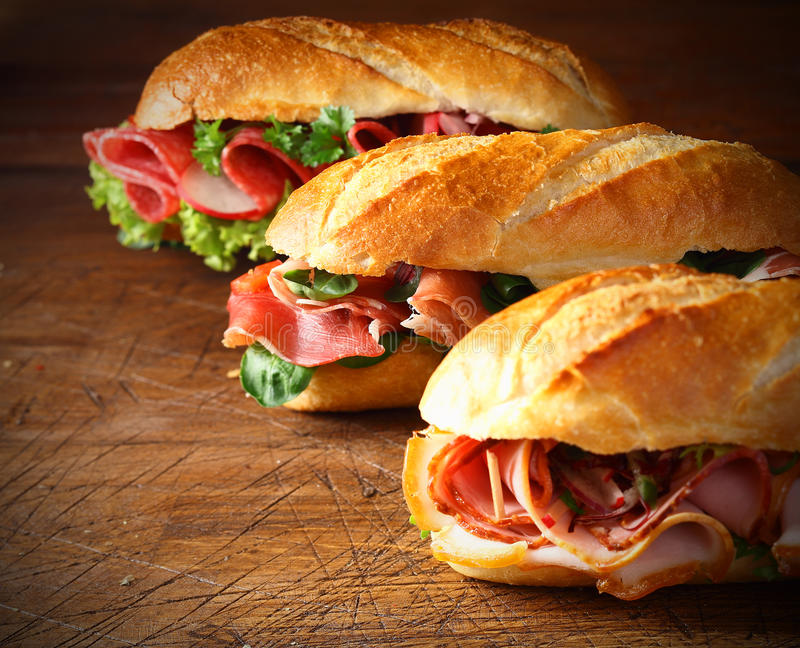 Assorted delicious baguette sandwiches royalty free stock image