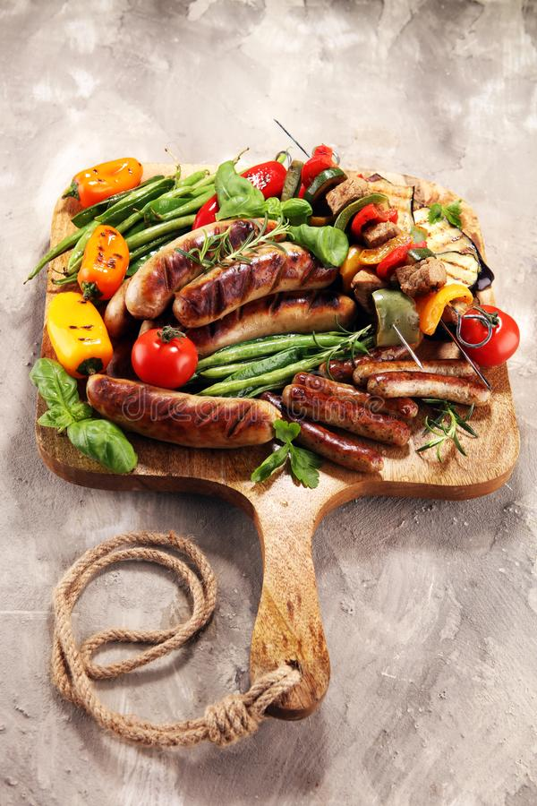 Assorted delicious grilled meat with vegetable on a barbecue. Grilled pork shish or kebab on skewers with vegetables . Food stock image