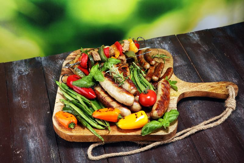 Assorted delicious grilled meat with vegetable on a barbecue. Grilled pork shish or kebab on skewers with vegetables . Food royalty free stock photo