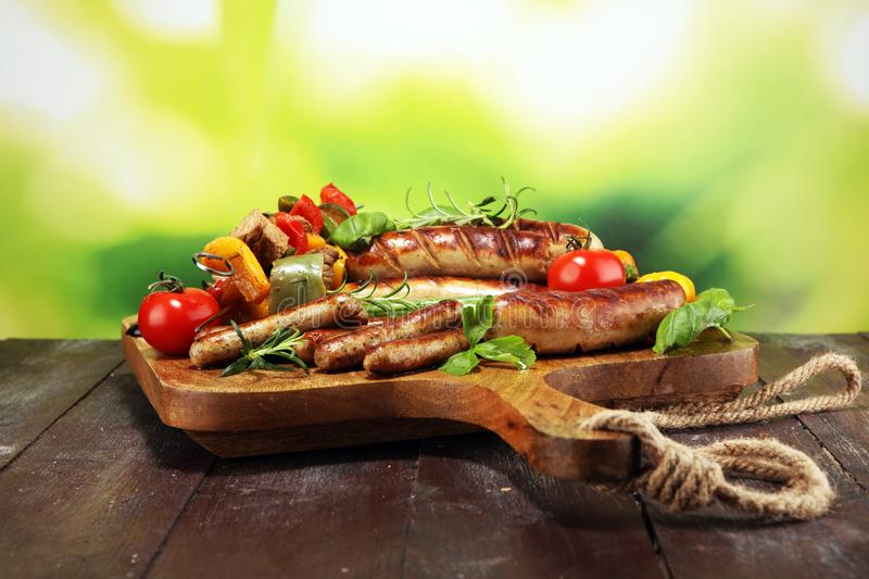 Assorted delicious grilled meat with vegetable on a barbecue. Grilled pork shish or kebab on skewers with vegetables . Food stock photography