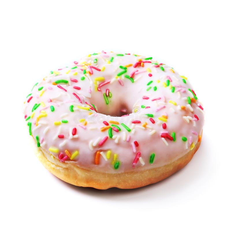 Assorted delicious homemade doughnuts in the glaze, colorful sprinkles and nuts isolated on white background. royalty free stock photo