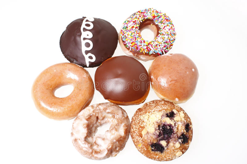 Assorted donuts. On a white background stock images