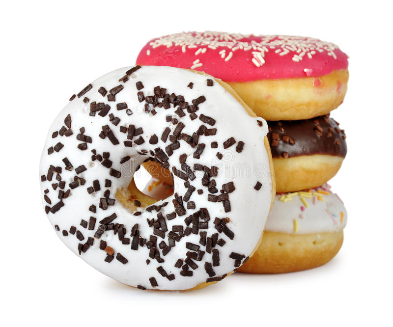 Assorted donuts. Pile of assorted donuts on a white background royalty free stock image
