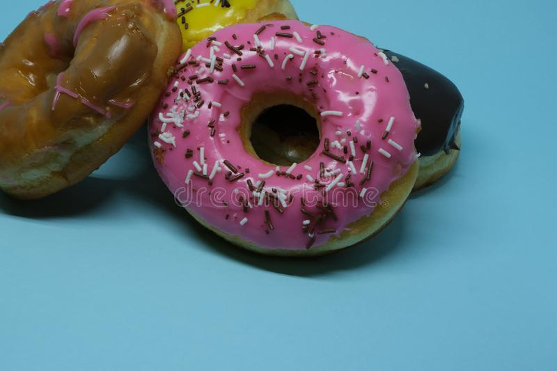 Assorted donuts on a blue background royalty free stock image