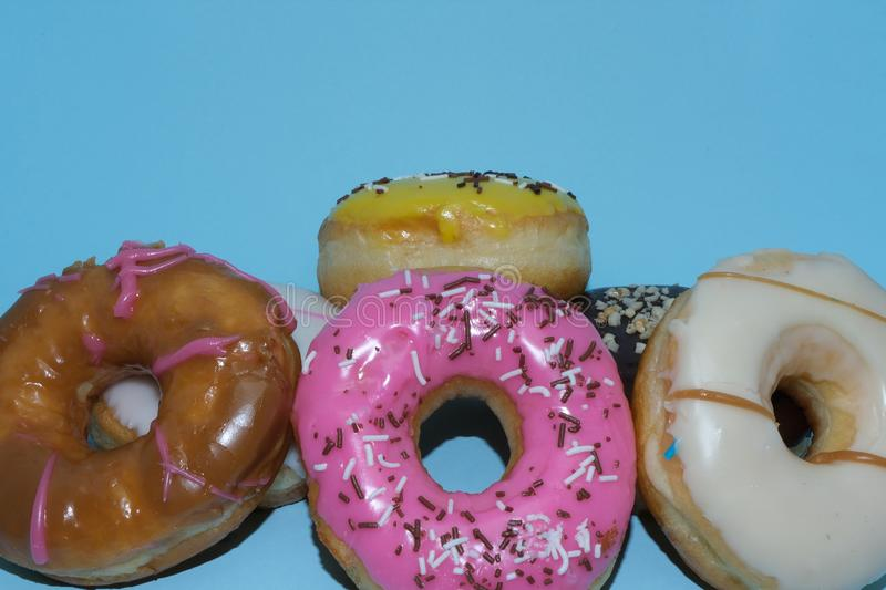 Assorted donuts on a blue background stock photo