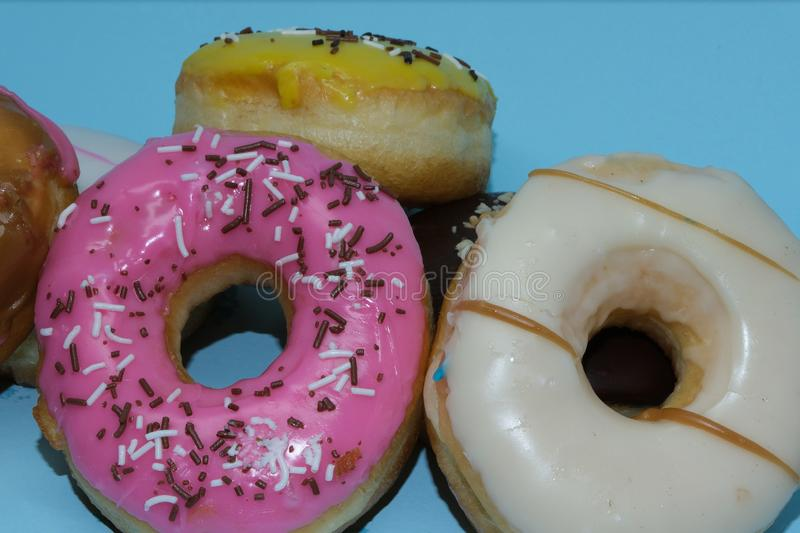 Assorted donuts on a blue background stock photos