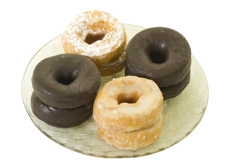 Assorted Donuts on Plate. Isolated, clipping path included royalty free stock photography