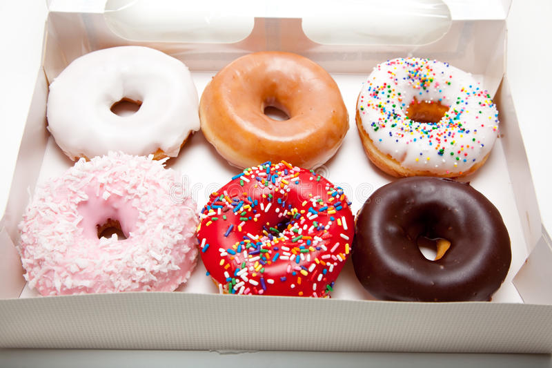 Assorted Donuts on white stock images