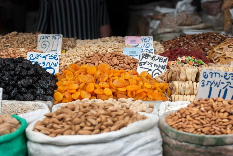 Assorted dried fruits and nuts for sale at Mahane Yehuda Market stock image