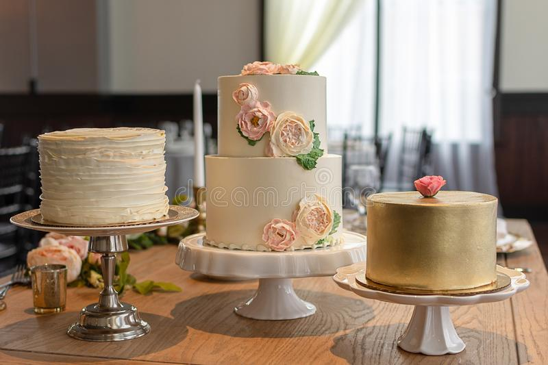 Assorted Elegant Wedding Cake Trio stock photo