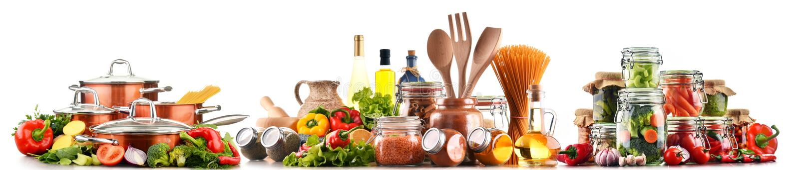 Assorted food products and kitchen utensils isolated on white. Background royalty free stock image
