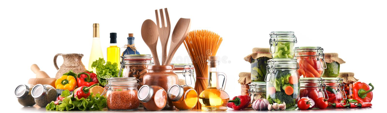 Assorted food products and kitchen utensils isolated on white. Background stock photography
