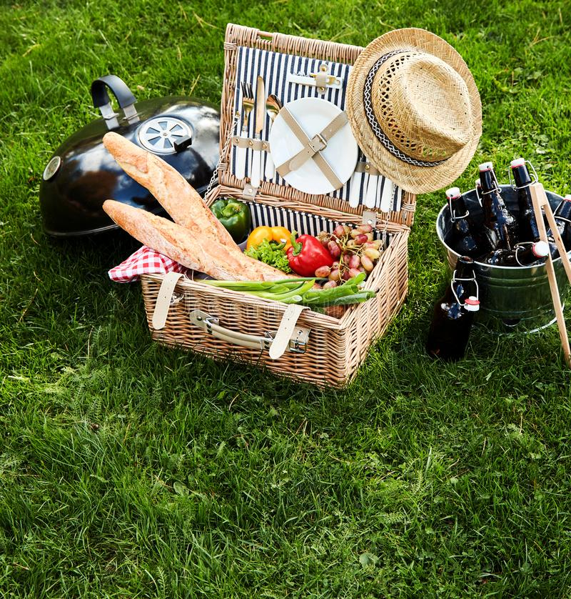 Assorted food sitting inside picnic basket stock photo