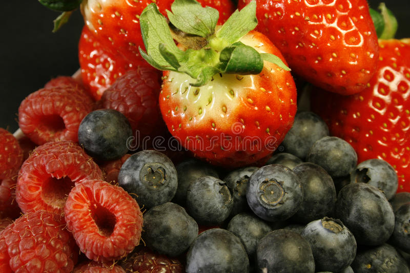 Assorted fresh berries stock image