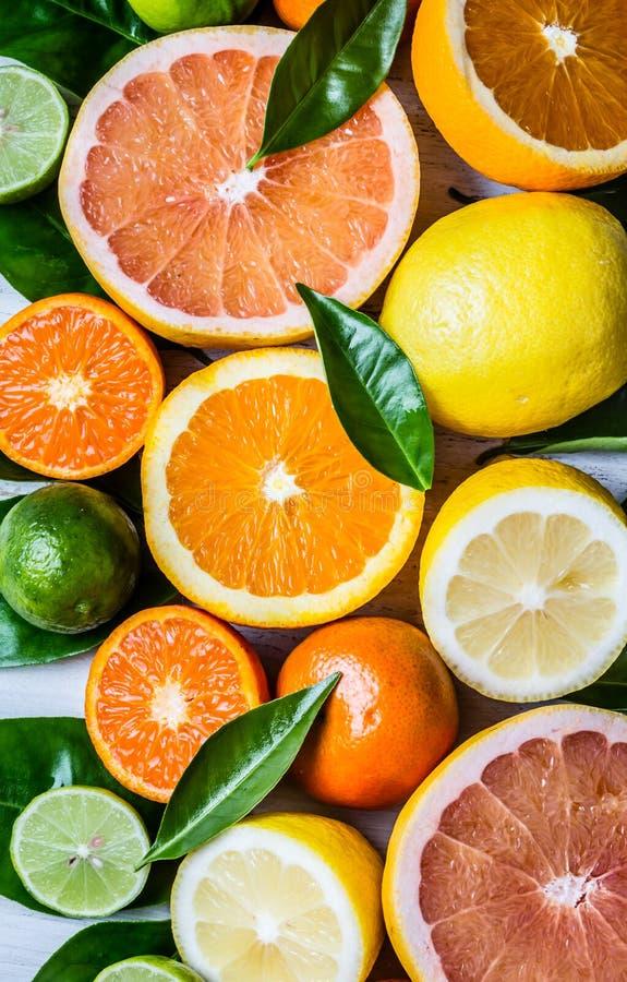 Assorted fresh citrus fruits with leaves. Background. Citrus background. Assorted fresh citrus fruits with leaves. Lemon, orange lime, grapefruit mandarin stock photos