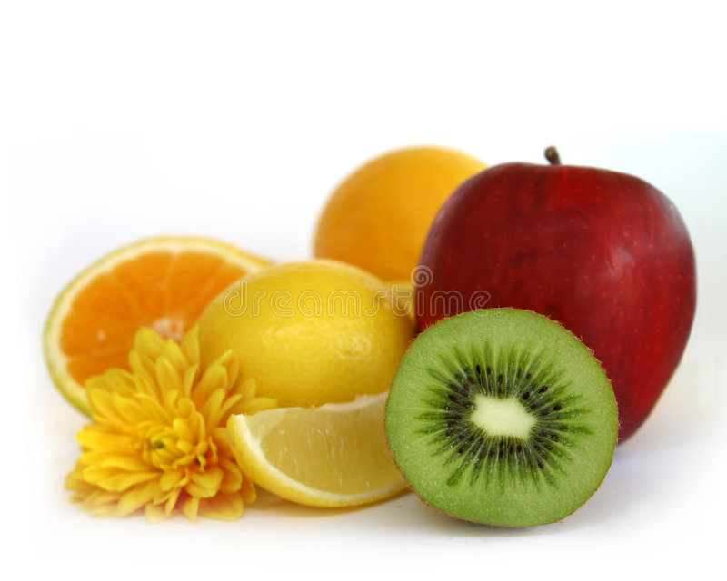 Assorted fresh fruits. With yelloy daisy stock image