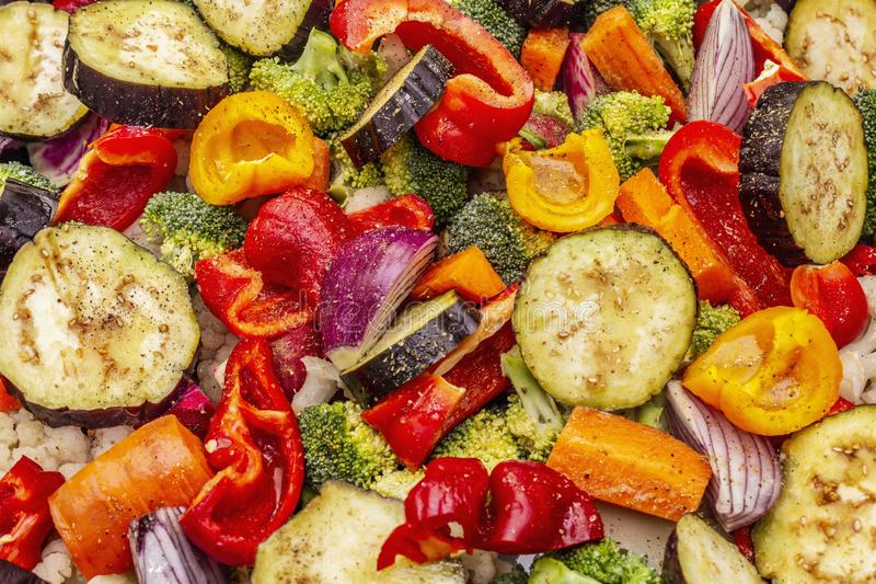 Assorted fresh vegetables on a baking sheet. Healthy food lifestyle. Salt, oil, spices stock image