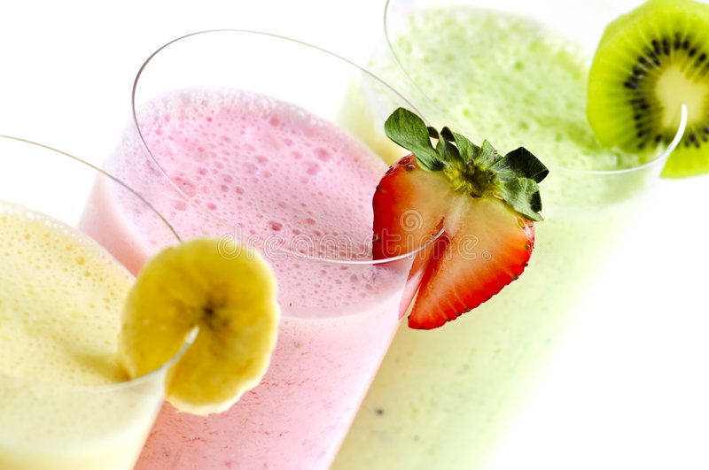 Assorted fruit smoothies royalty free stock image