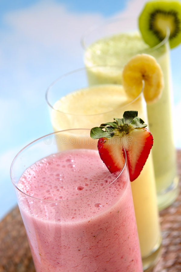 Assorted fruit smoothies stock photography