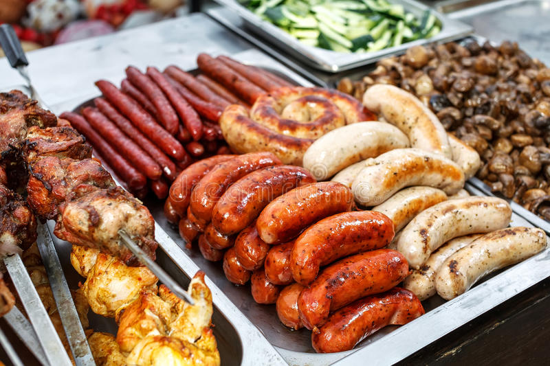 Assorted German sausages grilled in a steel container stock photography