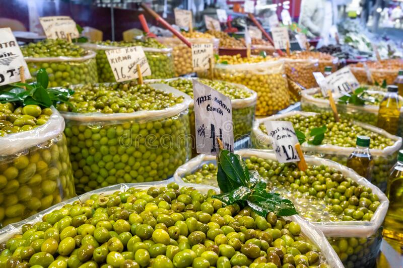 Assorted green and black olives at Turkish farmers market. royalty free stock image