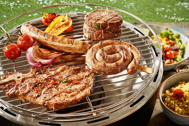 Assorted grilled meat on a gas barbecue stock photography