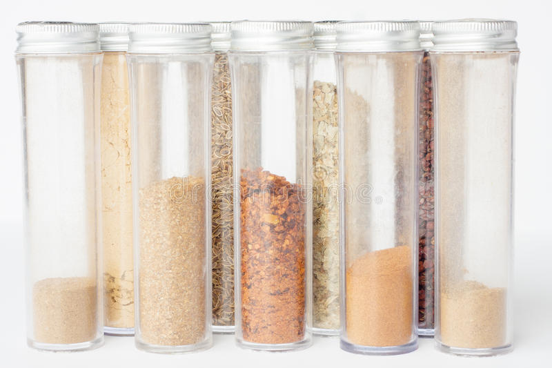 Assorted ground spices in bottles royalty free stock images
