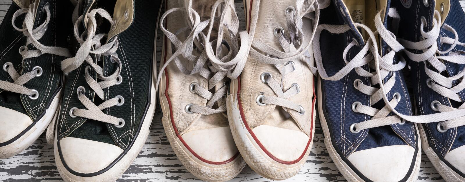 Assorted group of canvas, retro tennis shoes. Old, dirty, retro, classic, canvas tennis shoes assorted royalty free stock photo