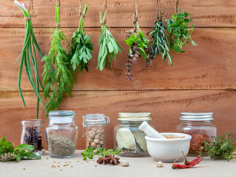 Assorted hanging herbs ,parsley ,oregano,sage,rosemary,sweet basil,dill,spring onion and set up with dry and fresh stock photo