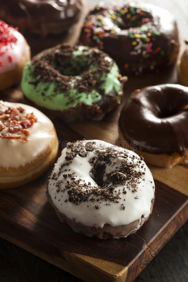 Assorted Homemade Gourmet Donuts. Assorted Homemade Gourmet Glazed Donuts on a Background stock photography