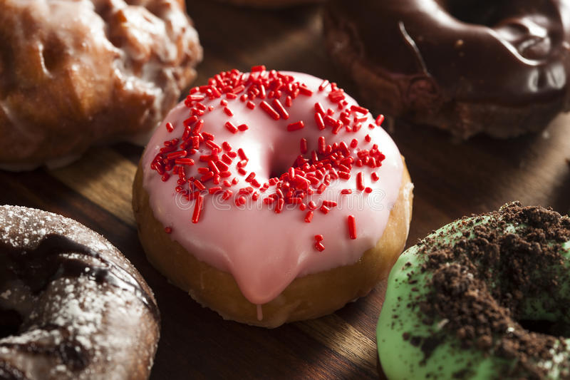Assorted Homemade Gourmet Donuts. Assorted Homemade Gourmet Glazed Donuts on a Background stock image