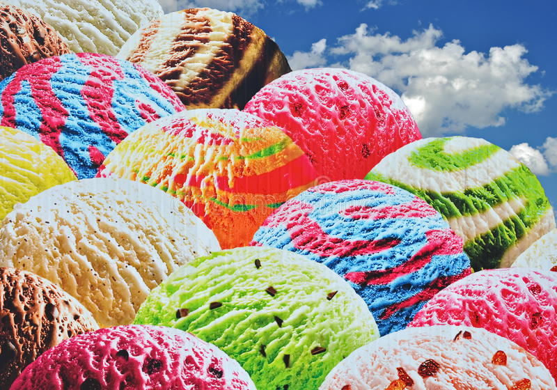 Ice Cream Scoops. Colorful ice cream scoops on a blue cloudy sky stock photo
