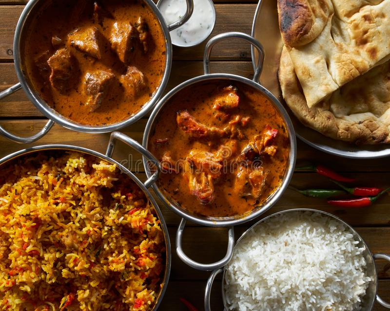 Assorted indian curry and rice dishes royalty free stock photography