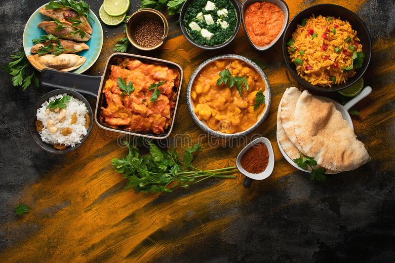 Assorted indian food on black background stock image