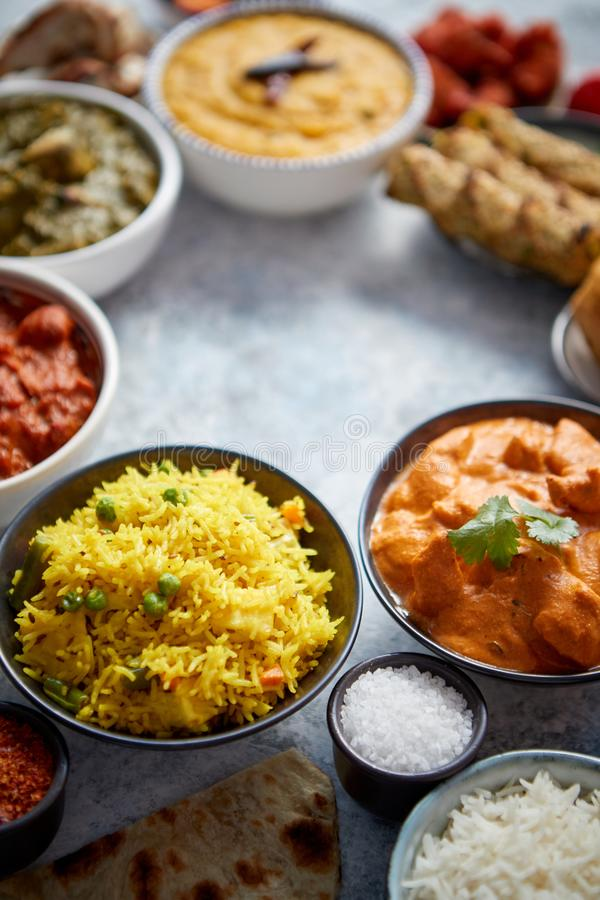 Assorted indian food on stone background. Dishes of indian cuisine royalty free stock photography