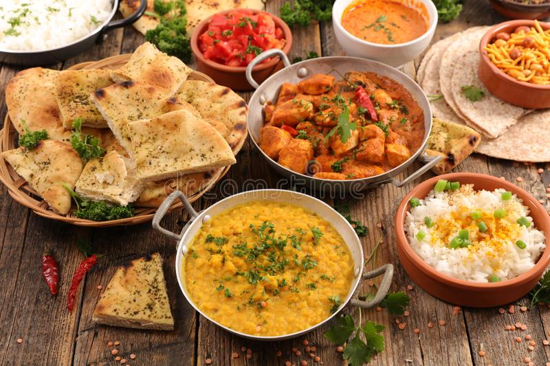 Assorted indian food. On wood stock images