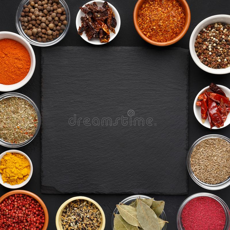 Assorted indian spices and herbs with space for text royalty free stock image