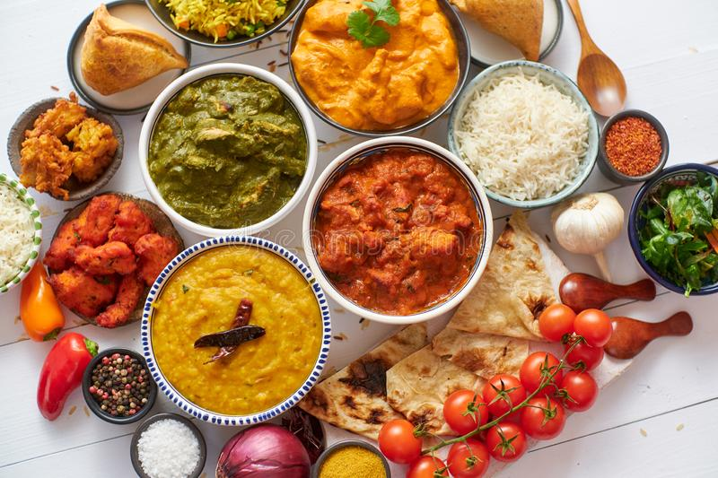 Assorted Indian various food with spices, rice and fresh vegetables royalty free stock image