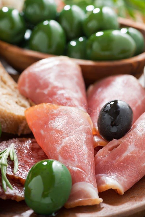 Assorted Italian Antipasti - Deli Meats, Olives And Ciabatta Stock Photo